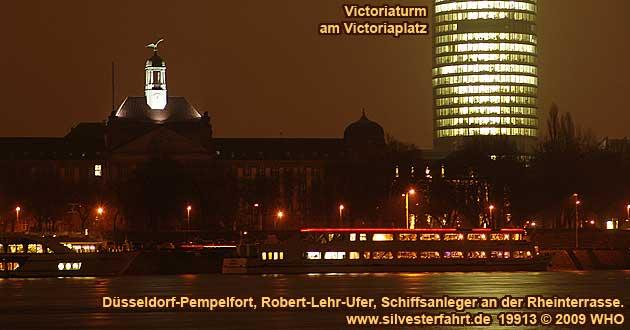 Rheinschiff s401eure-eur1 am Schiffsanleger  an der Rheinterrasse am Robert-Lehr-Ufer in Düsseldorf-Pempelfort. Im Hintergrund der Victoriaturm am Victoriaplatz.
